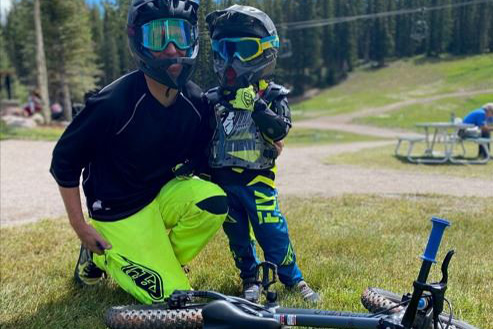 Kevin Jordan, of Snowmass Bike School, poses with young mountain biker.